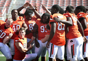 Photo - Oklahoma State football players pose for a photograph during Oklahoma State's football media day in Stillwater, Okla., Saturday, Aug. 4, 2012. Photo by Sarah Phipps, The Oklahoman