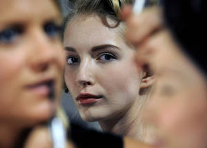 photo -   FILE - This Sept. 7, 2012 file photo shows a model waiting backstage before the showing of the Billy Reid Spring 2013 collection during Fashion Week in New York. Tweaking your makeup routine is something you probably could do today because it&#039;s changing how you wear the products more than a change in products themselves, says Linda Wells, editor in chief of Allure. (AP Photo/Louis Lanzano, file)  