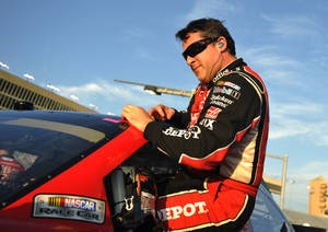 Photo -   Tony Stewart gets out of his car after taking the pole position during qualifying for Sunday's NASCAR Sprint Cup Series auto race at Atlanta Motor Speedway, Friday, Aug. 31, 2012, in Hampton, Ga. (AP Photo/Rainier Ehrhardt)