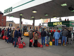 Photo -   Shortly before the gas ran out, customers wait in line at a Hess station where the line of cars snaked 10 blocks, and at least 60 people waited to fill red gas cans for their generators, in the Gowanus section of Brooklyn, New York, Friday morning, Nov. 2, 2012. Courier Winston Alfred said he had been there in his van since 4:20 am, and was second in line, when he was turned away four hours later. (AP Photo/David Caruso)