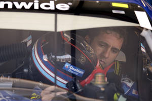 Photo - Elliott Sadler checks his helmet before practice for the NASCAR Nationwide Series STP 300 auto race at Chicagoland Speedway in Joliet, Ill., Saturday, July 20, 2013. (AP Photo/Nam Y. Huh)
