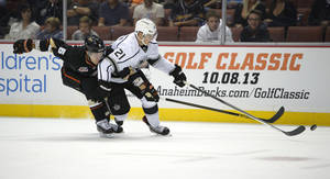 Photo - Anaheim Ducks defenseman Ben Lovejoy, left, vies for the puck with Los Angeles Kings right wing Matt Frattin during the first period of a preseason NHL hockey game, Tuesday, Sept. 17, 2013, in Anaheim, Calif.  (AP Photo/Mark J. Terrill)