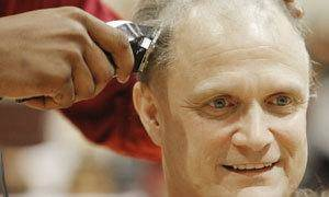 photo - Coach Scott Raper gets his head shaved by players during an assembly celebrating the Centennial boys state basketball championship in Oklahoma City , March 25 , 2011. Photo by Steve Gooch