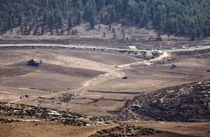 photo -   Israeli Army vehicles and helicopters are seen in an open area as they search for the remains of a drone in the Negev southern Israel, Saturday, Oct. 6, 2012. Israeli jets scrambled to intercept a drone that crossed into Israeli airspace Saturday from the Mediterranean Sea, bringing it down without incident in the south of the country, a military spokeswoman said. (AP Photo/Yehuda Lachiani) ISRAEL OUT