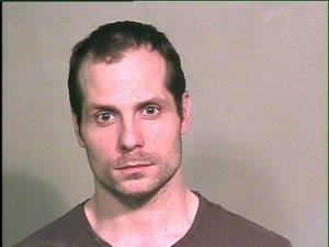 photo - Dustin Patrick Coyle, 34, was arrested on Wednesday on a complaint of domestic abuse and sexual assault on his ex-girlfriend after the two fought for possession of a cat