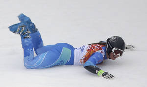 Photo - Slovenia's Tina Maze celebrates taking the lead in the second run of the women's giant slalom at the Sochi 2014 Winter Olympics, Tuesday, Feb. 18, 2014, in Krasnaya Polyana, Russia. (AP Photo/Charlie Riedel)