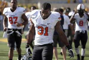 Photo - Oklahoma State running back Jeremy Smith's trend of diminishing rushing totals could put his status as the Cowboys' lead back in jeopardy. <strong></strong>