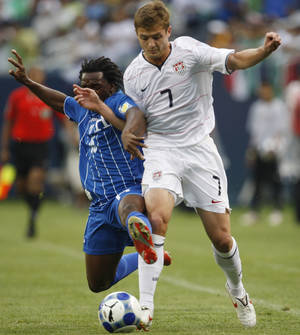 Photo - FILE- In this July 23, 2009 file photo, Honduras' Walter Martinez, left, strips the ball from United States' Robbie Rogers during the first half of a CONCACAF Gold Cup semifinal soccer game in Chicago. The Galaxy traded Mike Magee to his hometown Fire in exchange for the rights to Rogers, who will wear No. 14. If put on the field, as expected, Rogers will become the first openly gay athlete to play in a men's North American professional sports league Sunday, May 26, 2013. (AP Photo/Nam Y. Huh, File)
