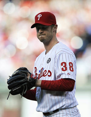 Photo - Philadelphia Phillies starting pitcher Kyle Kendrick reacts after giving up a three-run home run to Milwaukee Brewers' Ryan Braun in the third inning of a baseball game Tuesday, April 8, 2014, in Philadelphia. (AP Photo/Michael Perez)