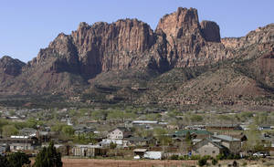 Photo -   FILE - Hildale, Utah sits at the base of red rock cliff mountains with its sister city, Colorado City, Ariz., in the foreground in this Thursday, April 20, 2006, file photo. A federal appeals court ruled Monday, Nov. 5, 2012, that the polygamist sect on the Utah-Arizona border waited too long to challenge a court-ordered takeover, clearing the way for state authorities to break up a church trust and sell assets including homes, businesses and farms in two small towns. A three-judge panel of the 10th U.S. Circuit Court of Appeals overturned a federal judge in Salt Lake City, who ruled nearly two years ago that Utah's takeover violated the constitutional rights of the Fundamentalist Church of Jesus Christ of Latter-Day Saints. (AP Photo/Douglas C. Pizac, File)