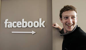 Photo - Facebook founder Mark Zuckerberg smiles at Facebook headquarters in Palo Alto, Calif.