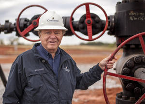 "Photo - Harold Hamm, founder and CEO of Continental Resources, owns the rights to more oil in the ground than anyone in America -- and he says its enough to wean the country off foreign sources of fossil fuel. This ""oil renassiance,"" as he calls it, is driven by newly refined methods of drilling, including the controversial use of hydraulic fracturing. Picture taken Oct. 18, 2013. (Jim Seida / NBC News)"