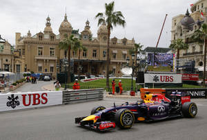 Photo - Red Bull driver Sebastian Vettel of Germany steers his car during the first free practice at the Monaco racetrack, in Monaco, Thursday, May 22, 2013. The  Monaco Formula One Grand Prix will be held on Sunday. (AP Photo/Claude Paris)