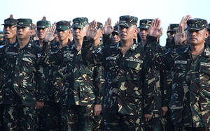 Photo - In this Nov. 11, 2012 photo released by the Philippine Army, Philippine peacekeeping officers line up before departing to Golan Heights at the Villamor Air Base at a Manila suburb, in the Philippines. The Philippine government said Thursday, March 7, 2013 that talks were under way for the release of 21 unarmed Filipino U.N. peacekeepers who were detained by Syrian rebels in the Golan Heights in the increasingly volatile zone separating Israeli and Syrian troops. (AP Photo/Philippine Army) NO SALES