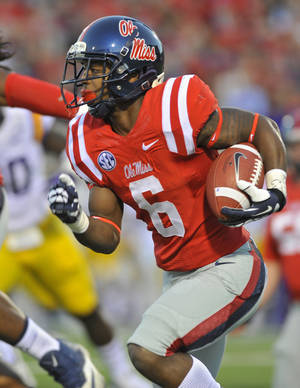 Photo - Mississippi running back Jaylen Walton (6) rushes for a first down during the first half of an NCAA college football game against No. 6 LSU on Saturday, Oct. 19, 2013, in Oxford, MS. Mississippi won 27-24. (AP Photo/ The Daily Mississippian, Austin McAfee)