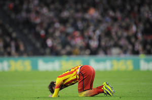 Photo - Barcelona's Neymar da Silva of Brazil, lies on the pitch during their Spanish League soccer match against Athletic Bilbao, at San Mames stadium in Bilbao, Spain, Sunday, Dec. 1, 2013. F.C. Barcelona lost the match 1-0. (AP Photo/Alvaro Barrientos)