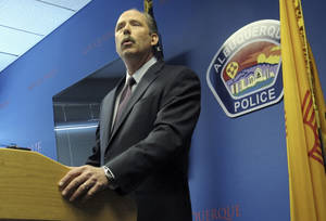 Photo - Albuquerque Mayor Richard Berry speaks to reporters Thursday April 10, 2014, after the U.S. Justice Department released a report in response to a series of deadly Albuquerque police shootings. The report pointed to patterns of excessive force by the Albuquerque Police Department, serious constitutional violations and a lack of training and oversight of its officers. (AP Photo/Russell Contreras)