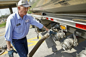 photo - Tanker driver Glenn Goddard makes a gasoline delivery to fill the in ground tanks at the OnCue Station #101 at 23rd St. and Santa Fe Ave. on Wednesday, March 28 2012, in Oklahoma City, Oklahoma.  Photo by Chris Landsberger, The Oklahoman