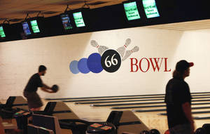 Photo - Bowlers take to the lanes 66 Bowl in Oklahoma City on Wednesday. The bowling alley at NW 39 and Willow Springs Avenue turns 50 this year. PHOTO BY BRYAN TERRY, THE OKLAHOMAN