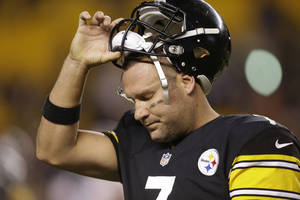 Photo - Pittsburgh Steelers quarterback Ben Roethlisberger (7) tugs his helmet off as he leaves the field in the fourth quarter as his team is losing to the Chicago Bears in  an NFL football game in Pittsburgh, Sunday, Sept. 22, 2013. The Steelers lost 40-23. (AP Photo/Gene J. Puskar)