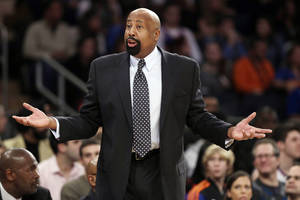Photo - New York Knicks' Mike Woodson argues a call during the first half of an NBA basketball game against the Toronto Raptors, Friday, Dec. 27, 2013, in New York. (AP Photo/Frank Franklin II)