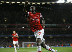 Photo -   Arsenal's Gervinho celebrates after scoring the opening goal during the Champions League Group B soccer match between Arsenal and Olympiakos at the Emirates Stadium in London, Wednesday, Oct. 3, 2012. (AP Photo/Kirsty Wigglesworth)
