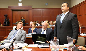 Photo - George Zimmerman, right, stands up at the defense table with his attorneys, Mark O'Mara, left, and Don West, center, as he is identified by state witness Doris Singleton, a Sanford police officer, during her testimony in Zimmerman's trial in Seminole circuit court, in Sanford, Fla., Monday, July  1, 2013. Zimmerman has been charged with second-degree murder for the 2012 shooting death of Trayvon Martin.(AP Photo/Orlando Sentinel, Joe Burbank, Pool)