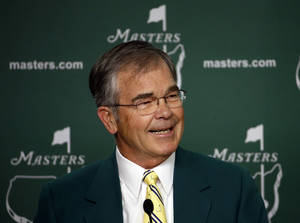 Photo - Billy Payne, chairman of Augusta National Golf Club, speaks during a press conference before the Masters golf tournament Wednesday, April 9, 2014, in Augusta, Ga. (AP Photo/Matt Slocum)