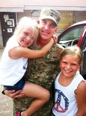 Photo - 1st Sgt. Matt Boyer currently deployed in Afghanistan with daughters Emily, 6, and Abby, 9. Boyer also is an Oklahoma City fireman. <strong>Provided</strong>