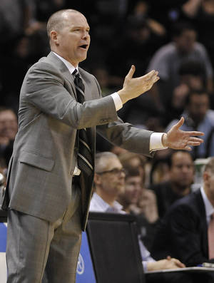 Photo - Sacramento Kings head coach Michael Malone reacts to a call during the second half of an NBA basketball game against the San Antonio Spurs on Sunday, Dec. 29, 2013, in San Antonio. San Antonio won 112-104. (AP Photo/Darren Abate)