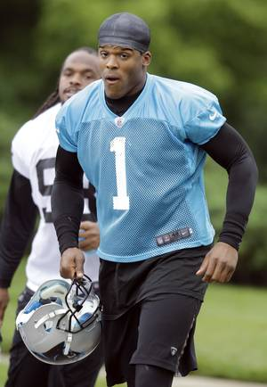 "Photo -   In this photo taken June 12, 2012, Carolina Panthers quarteback Cam Newton arrives for NFL football practice in Charlotte, N.C. Newton has endured plenty of criticism during his brief football career, but the rookie continues to shrug it off and prove people wrong. He says ""If I listened to all every critic I would have given up the game a long time ago."" (AP Photo/Chuck Burton)"