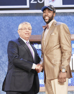 Photo - NBA commissioner David Stern, left, shakes hands with Arizona State's James Harden, who was selected by the Thunder during the first round of the NBA Draft on Thursday in New York. AP Photo