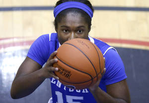 Photo - Kentucky guard Linnae Harper eyes a free throw during the second half of an NCAA college basketball game against DePaul Thursday, Dec. 12, 2013, in Chicago. Kentucky won 96-85. (AP Photo/Charles Rex Arbogast)