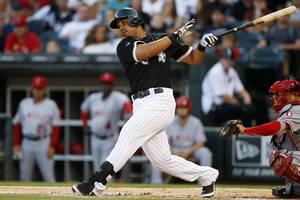 Photo - Chicago White Sox's Jose Abreu hits a single against the Los Angeles Angels during the first inning of the second baseball game of a double header on Tuesday, July 1, 2014, in Chicago. (AP Photo/Andrew A. Nelles)