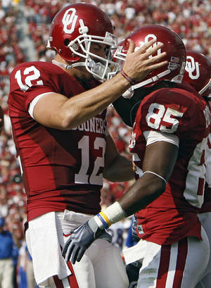 Photo - Oklahoma's Landry Jones (12) and Ryan Broyles (85) celebrate a touchdown during the first half of the college football game between The University of Oklahoma Sooners (OU) and The University of Tulsa Hurricanes (TU) at the Gaylord Family -- Oklahoma Memorial Stadium on Saturday, Sept. 19, 2009, in Norman, Okla.   PHOTO BY CHRIS LANDSBERGER, The Oklahoman