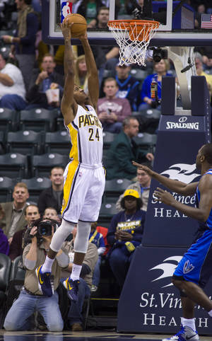 photo -   Indiana Pacers' Paul George (24) takes the ball to the basket for a slam dunk during the first half of an NBA basketball game against the Dallas Mavericks in Indianapolis, Friday, Nov. 16, 2012. (AP Photo/Doug McSchooler)
