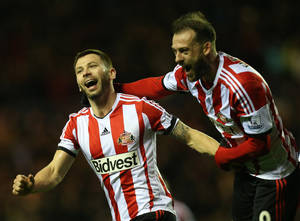 Photo - Sunderland's captain Phil Bardsley, left, celebrates his goal   with his teammates during their English League Cup semifinal first leg soccer match against Manchester United at the Stadium of Light, Sunderland, England, Tuesday, Jan. 7, 2014. (AP Photo/Scott Heppell)