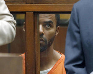 Photo - Former NFL safety Darren Sharper sits in Los Angeles Superior Court Thursday, March 13, 2014.  Sharper must remain in a Los Angeles jail without bail after he was indicted in Arizona on charges of drugging and sexually assaulting two women, a California judge ruled Thursday.  While making her decision, Superior Court Judge Renee Korn rejected a motion by Sharper's lawyers to release him on house arrest and said Arizona authorities want to extradite the Super Bowl champion to face trial in that state after he is tried on similar charges in California. He was previously released on $1 million bail in the California case but turned himself in on Feb. 27 after an arrest warrant was issued in New Orleans. He has not been charged in that state.  (AP Photo/Nick Ut )