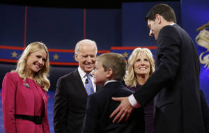 photo -   Vice President Joe Biden, center, and his wife Jill Biden, meet with Republican vice presidential candidate, Rep. Paul Ryan, R-Wis., right, his wife Janna Ryan, left, and son Charlie Ryan, center, on stage after the vice presidential debate, at Centre College in Danville, Ky., Thursday, Oct. 11, 2012. (AP Photo/Pablo Martinez Monsivais)