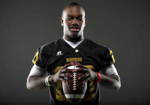 Photo - All-State football player James Flanders, of Midwest City, poses for a photo in Oklahoma CIty, Wednesday, Dec. 14, 2011. Photo by Bryan Terry, The Oklahoman