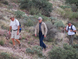 Photo - This Jan. 30, 2014, photo shows Jack Carlson of Bloomington, Minn., followed by Otto Oster of Mobridge, S.D., and Albert Rudin of Williamsburg, Iowa, as they hike Superstition Mountain east of Phoenix, Ariz. (AP Photo/Joe Kafka)