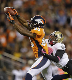 Photo -   Denver Broncos wide receiver Demaryius Thomas (88) makes a leaping catch against New Orleans Saints cornerback Patrick Robinson (21) in the first quarter of an NFL football game, Sunday, Oct. 28, 2012, in Denver. (AP Photo/Jack Dempsey)