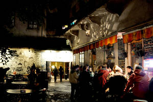 "Photo - The eclectic ""ruin pub"" scene in Budapest, Hungary, usually spills out of the bars and into courtyards.  Photo by Cameron Hewitt"