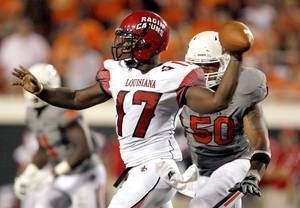 photo - Oklahoma State's Jamie Blatnick, right, pressures Louisiana-Lafayette's Blaine Gautier (17) in the second half of the college football game between the Oklahoma State Cowboys (OSU) and the University of Louisiana at Lafayette (ULL) Ragin' Cajuns at Boone Pickens Stadium in Stillwater, Okla., Saturday, Sept. 3, 2011. Photo by Sarah Phipps, The Oklahoman