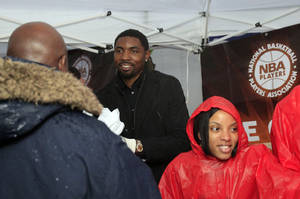 photo -   NBA Player Roger Mason, Jr., joins volunteers as they distribute turkeys in Harlem as Part of Association's Nationwide Season of Feeding Tuesday, Nov. 22, 2011, in New York. After filing two separate antitrust lawsuits against the league in different states, NBA players are consolidating their efforts and have turned to the courts in Minnesota as their chosen venue. (AP Photo/Frank Franklin II)