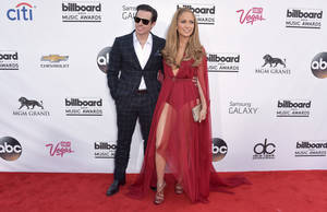 Photo - Casper Smart, left, and Jennifer Lopez arrive at the Billboard Music Awards at the MGM Grand Garden Arena on Sunday, May 18, 2014, in Las Vegas. (Photo by John Shearer/Invision/AP)
