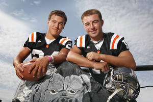 Photo - WAYNE HIGH SCHOOL FOOTBALL: Dynamic Duo portrait of Wayne football players Josh Way (24) and Sam Martin (11) for the Class A page of the special section on Saturday, August 20, 2011, in Wayne, Okla.   Photo by Steve Sisney, The Oklahoman ORG XMIT: KOD