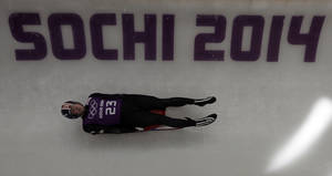 Photo - Chris Mazdzer of the United States completes a training run at the luge track for the men's singles luge at the 2014 Winter Olympics, Tuesday, Feb. 4, 2014, in Krasnaya Polyana, Russia. (AP Photo/Natacha Pisarenko)