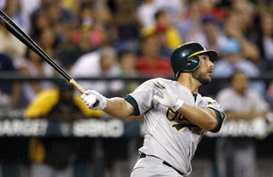 Photo -   Oakland Athletics' George Kottaras watches his three-run home run against the Seattle Mariners in the fourth inning of a baseball game Friday, Sept. 7, 2012, in Seattle. (AP Photo/Elaine Thompson)