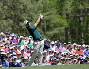Photo - Adam Scott, of Australia, tees off on the 12th hole during the first round of the Masters golf tournament Thursday, April 10, 2014, in Augusta, Ga. (AP Photo/David J. Phillip)